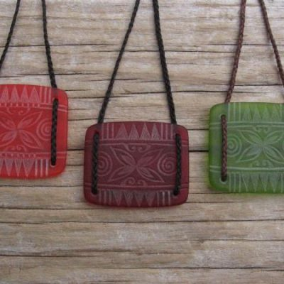 Tapa flower design engraved glass square pendants $72 ORANGE; RED; LIGHT GREEN Colours available - amber, orange, light red, dark red, pale green, lime green, mid-green, dark green, moss green, aqua green, turquoise blue, sapphire blue, teal blue, cobalt/dark blue, pale lavender, purple