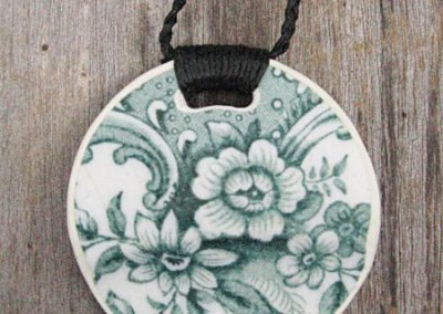 Round china pendant,with binding feature on plaited cord, small size. This china is historic - from the 1800s $56 China available changes all the time...some of these patterns may no longer be in stock but a similar design can be provided.