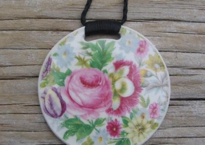 Round china pendant,with binding feature on plaited cord, floral pattern, medium size. $60 China available changes all the time...some of these patterns may no longer be in stock but a similar design can be provided.
