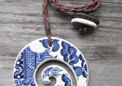 Recycled china carved koru or spiral pendant - Willow pattern