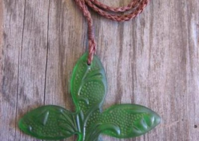 Antique pressed glass tapa flower carved pendant on height adjustable cord $56 MID GREEN Colours available: amber, purple, red, mid green, turquoise blue, clear, pale blue