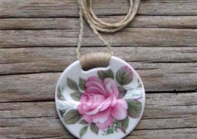 Round china pendant,with binding feature on plaited linen cord, small size. $56 China available changes all the time...some of these patterns may no longer be in stock but a similar design can be provided.