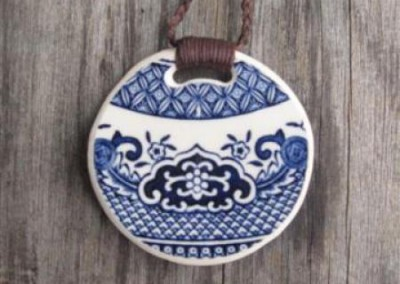Round china pendant,with binding feature on plaited cord, small size. Crown Lynn 'Blue Willow' $56 China available changes all the time...some of these patterns may no longer be in stock but a similar design can be provided.