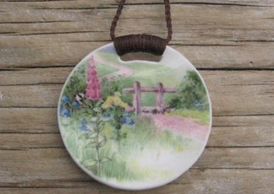 Round china pendant,with binding feature on plaitedcord, medium size. $60 China available changes all the time...some of these patterns may no longer be in stock but a similar design can be provided.