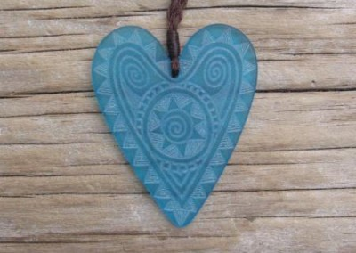 Engraved glass heart pendant on adjustable cord $88 TURQUOISE BLUE Colours available - amber, orange, light red, dark red, pale green, lime green, mid-green, dark green, moss green, aqua green, turquoise blue, sapphire blue, teal blue, cobalt/dark blue, pale lavender, purple