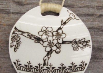 Round china pendant,with binding feature on plaited cord, medium size. This china is historic - from the 1800s $60 China available changes all the time...some of these patterns may no longer be in stock but a similar design can be provided.