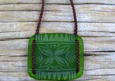 Tapa flower design engraved glass square pendant $72 LIGHT GREEN Colours available - amber, orange, light red, dark red, pale green, lime green, mid-green, dark green, moss green, aqua green, turquoise blue, sapphire blue, teal blue, cobalt/dark blue, pale lavender, purple