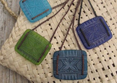 Tapa flower design engraved glass pendants - turquoise blue, light green, teal blue, cobalt blue