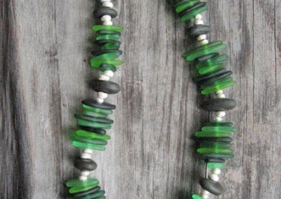 Large green glass necklace with hand-shaped glass beads, hand-shaped sterling silver beads and found beach stones, on a wire cord with sterling silver finishing