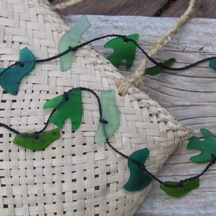 Carved glass four bird (tui; riroriro; kereru; fantail/piwakawaka) necklace - shades of green