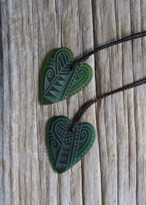 Engraved glass koru and lancewood heart pendant